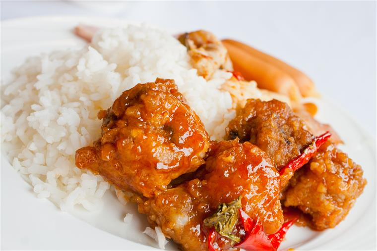 fried chicken in spicy sauce with side of white rice