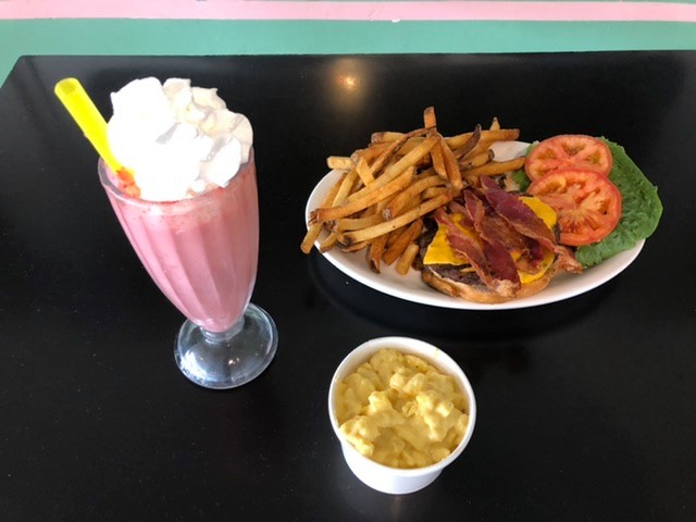 bacon cheeseburger with side of fries and strawberry shake