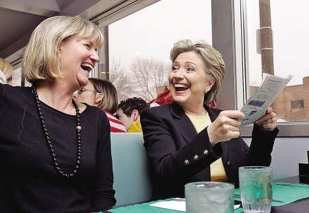 Hillary Clinton smiling with guests