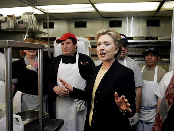 Hillary Clinton with employees in the back kitchen