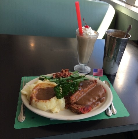 meatloaf and mashed potatoes with gravy and a chocolate shake