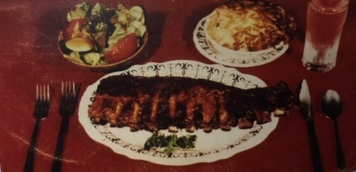 plate of ribs with two plates of sides