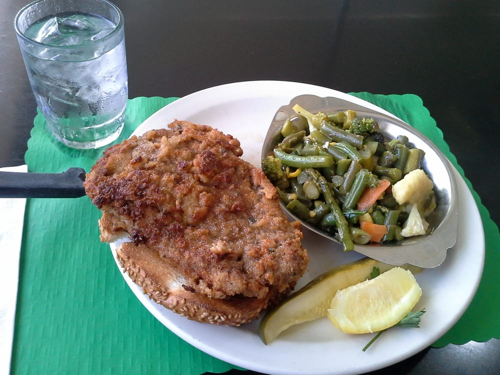 fried steak with side of greens