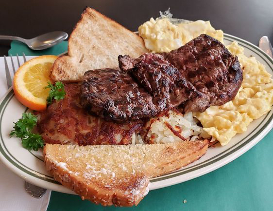 steak and eggs with toast and hash browns