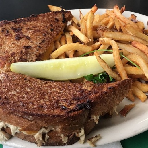 tuna melt sandwich with fries and a pickle