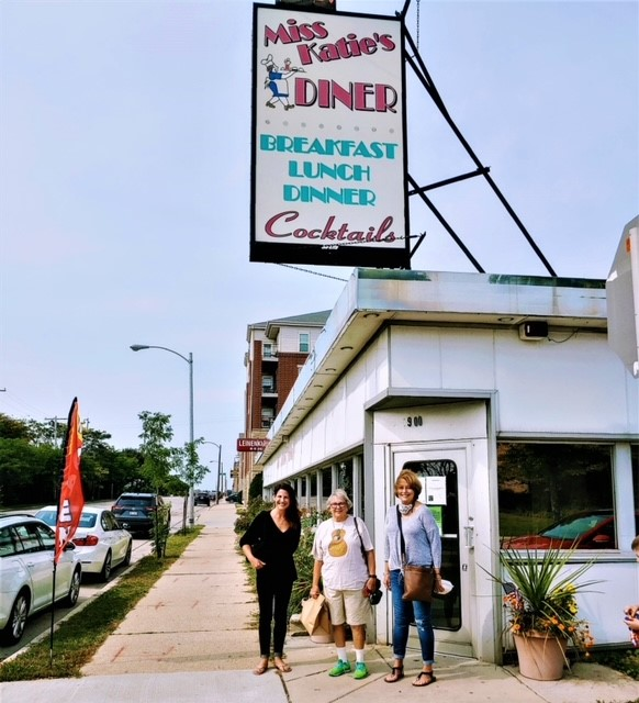 Customers in front of Miss Katie's Diner outside