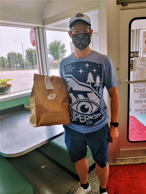 Customer with mask picking up order