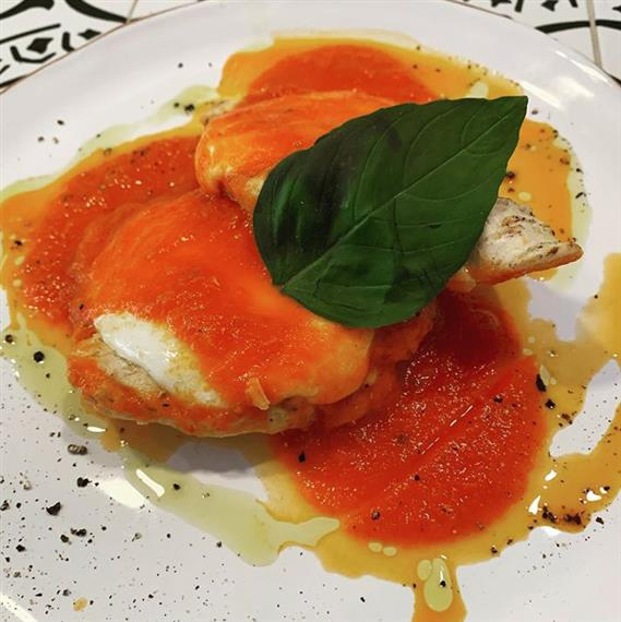 Ravioli topped with tomato sauce and basil