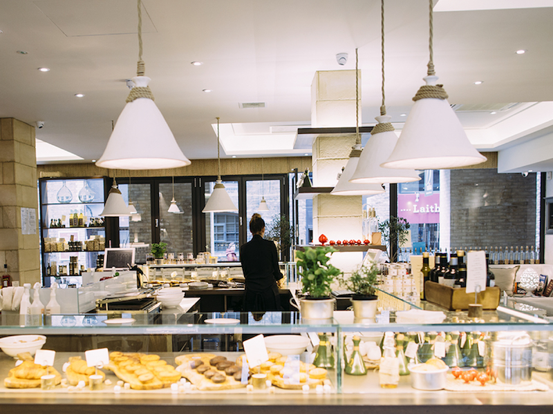 The front counter with glass display cases of pastries