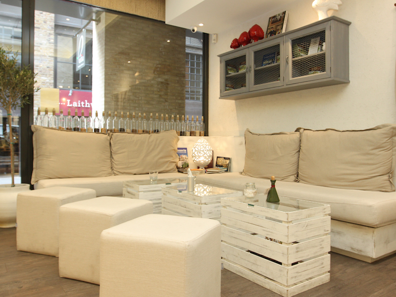A lounge area with couch seating and coffee tables