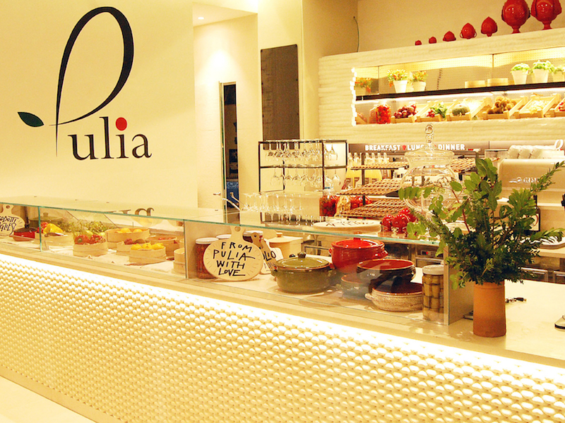 The front counter with a glass shelf filled with pastries