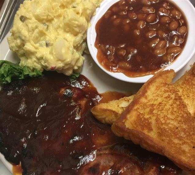 ribs with potato salad, beans and toast.