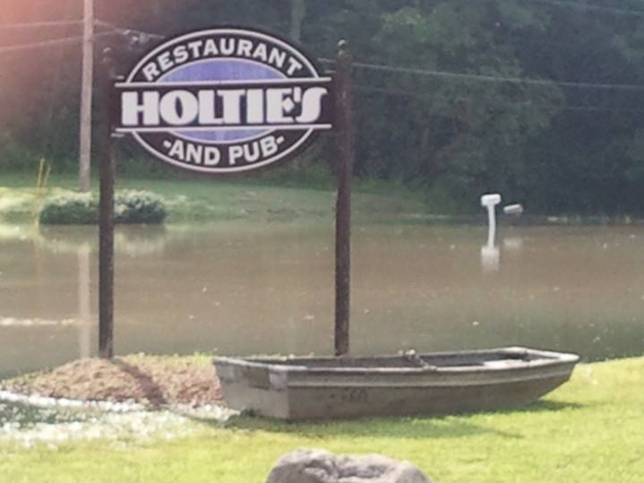 front sign and a small boat out front during the flood.