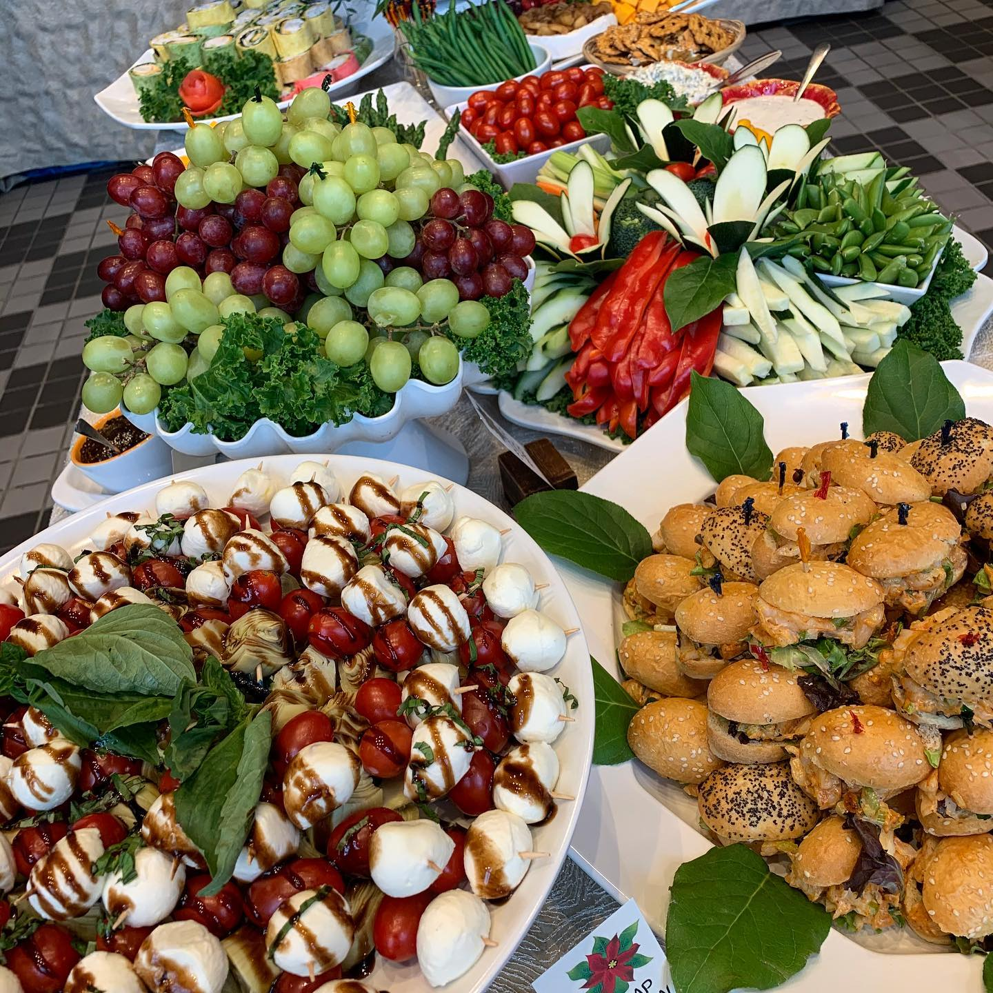 assorted fruits, salads and appetizer platters for an event