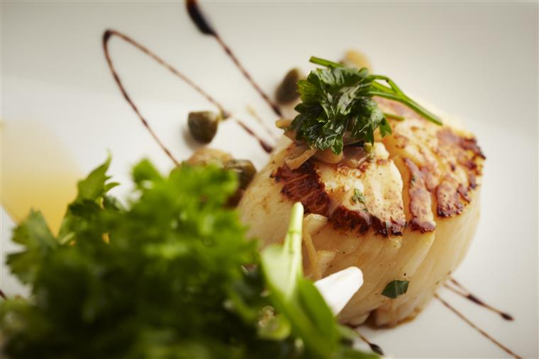 grilled scallop topped with garnish