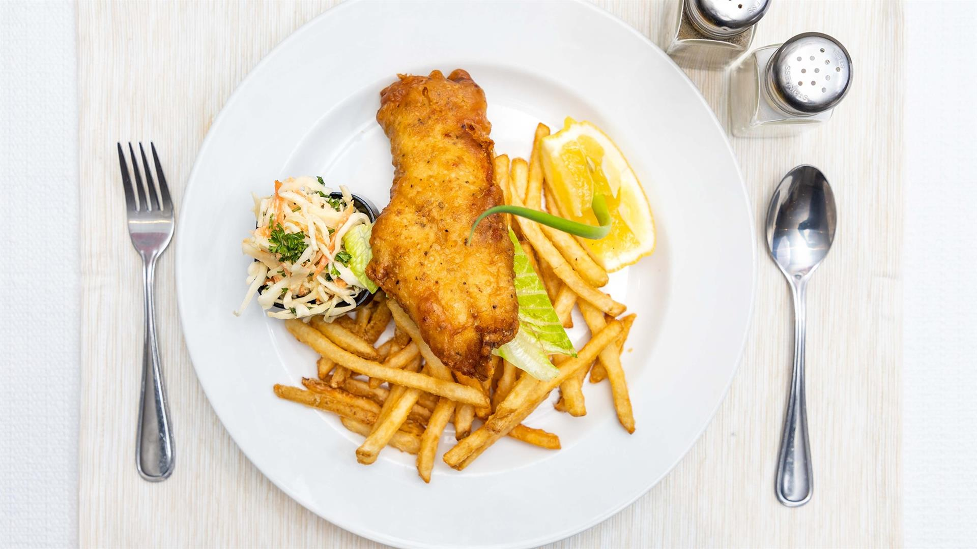 Fish and Chips served with coleslaw and tartar sauce