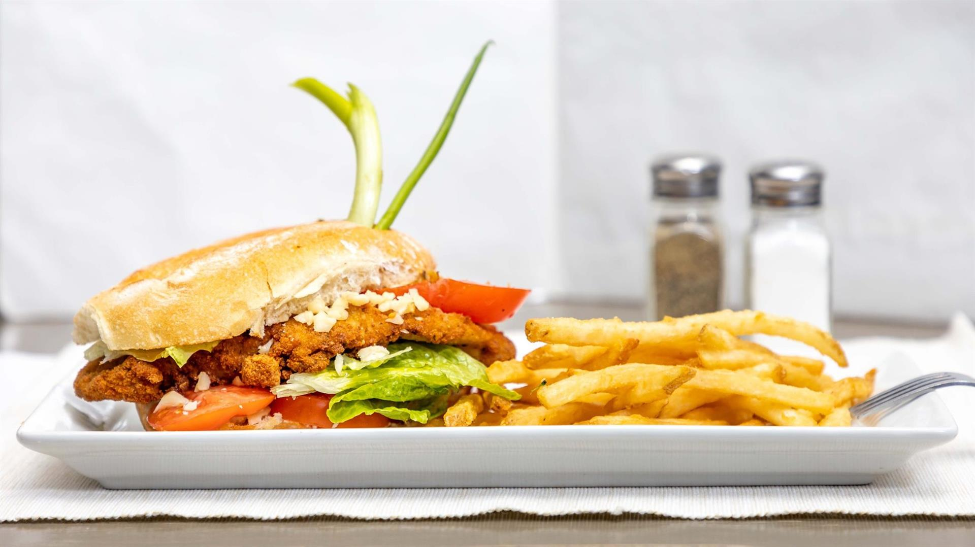 Club Sandwich with bacon, chicken, tomato, cheddar, lettuce and chipotle or regular mayo served with fries or soup of the day
