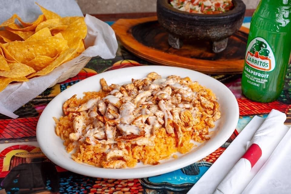 chicken and rice with cream cheese sauce served with chips and salsa & jarritos soda