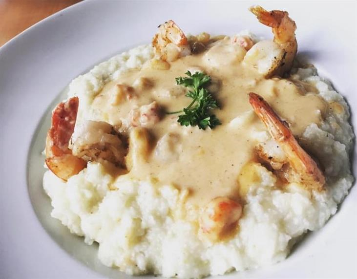 Shrimp and Grits: creamy grits, gulf shrimp, andouille, and saffron sauce
