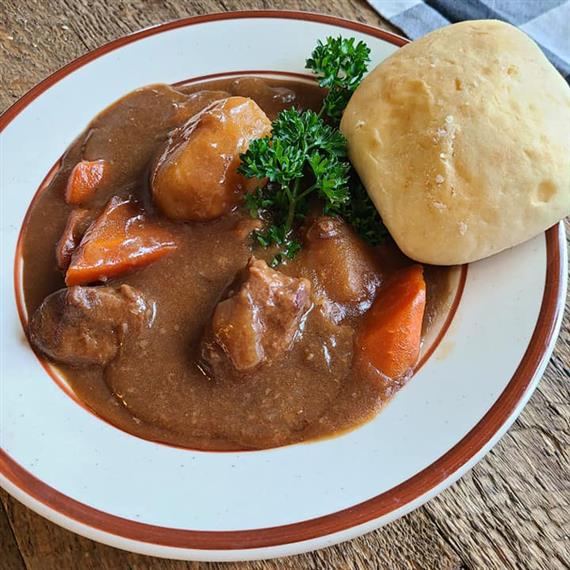 Beef stew with a side of bread