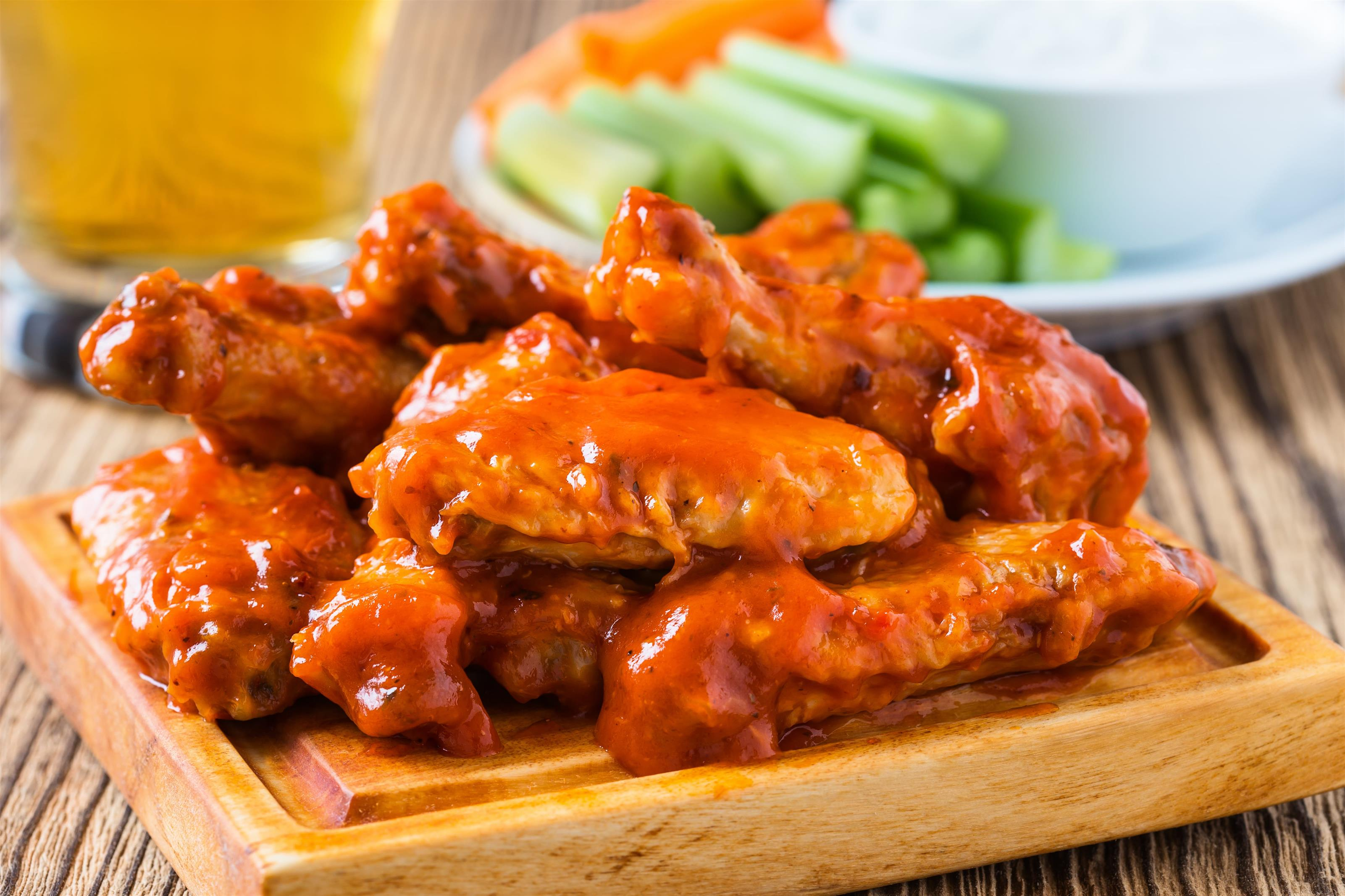 chicken wings tossed in buffalo sauce