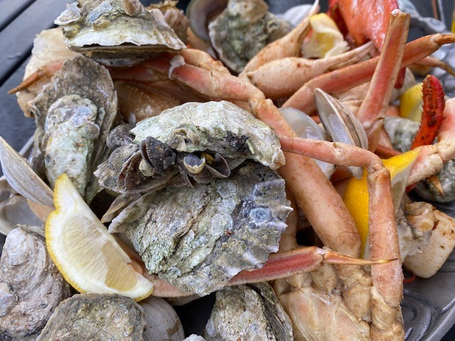 clams and crab legs tossed in seasonings and steamed