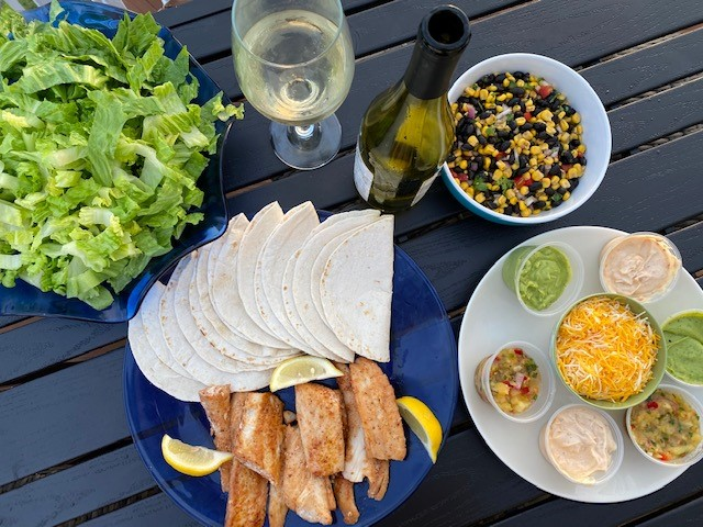 chicken taco platter with All the fixin's to create your own fresh tacos. Choice of fish, shrimp, chicken OR combination of 2. Includes crisp romaine, black beans & corn salsa, avocado crema, and cajun remoulade.