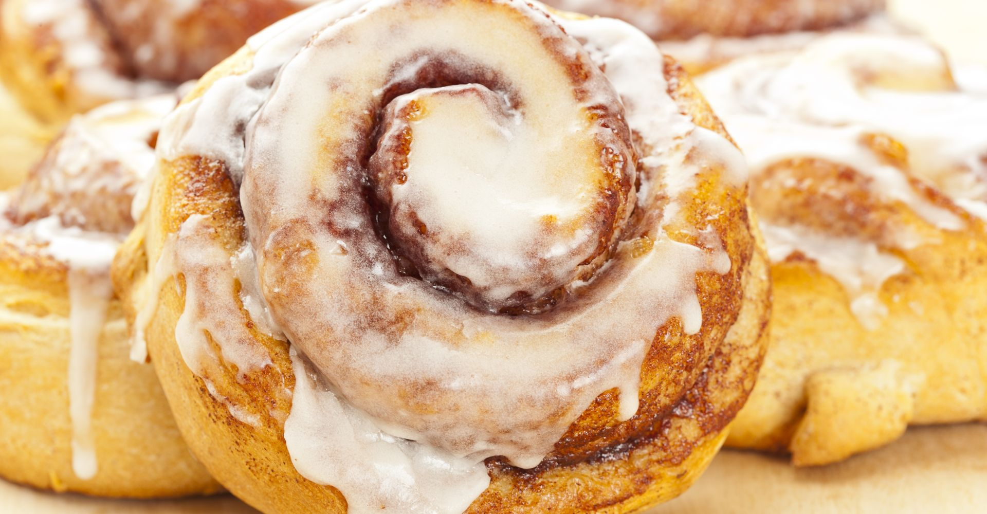 cinnamon rolls with icing on a plate