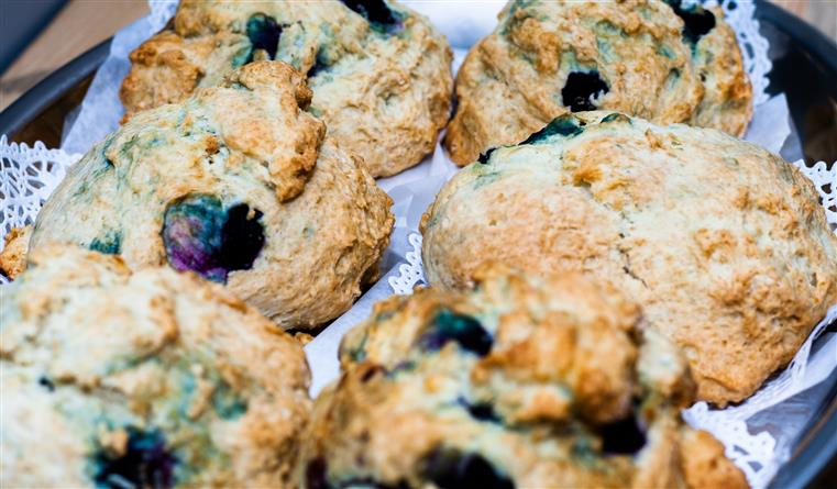 dish of freshly baked blueberry scones wrapped in paper