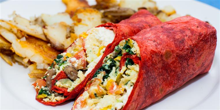 breakfast burrito with eggs, spinach, tomatoes, mushrooms, and cheese, side of home fries