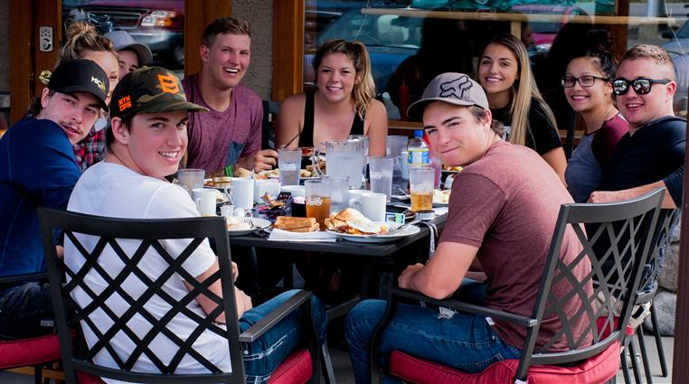 Teenagers dining on the patio at Spinnaker Cafe