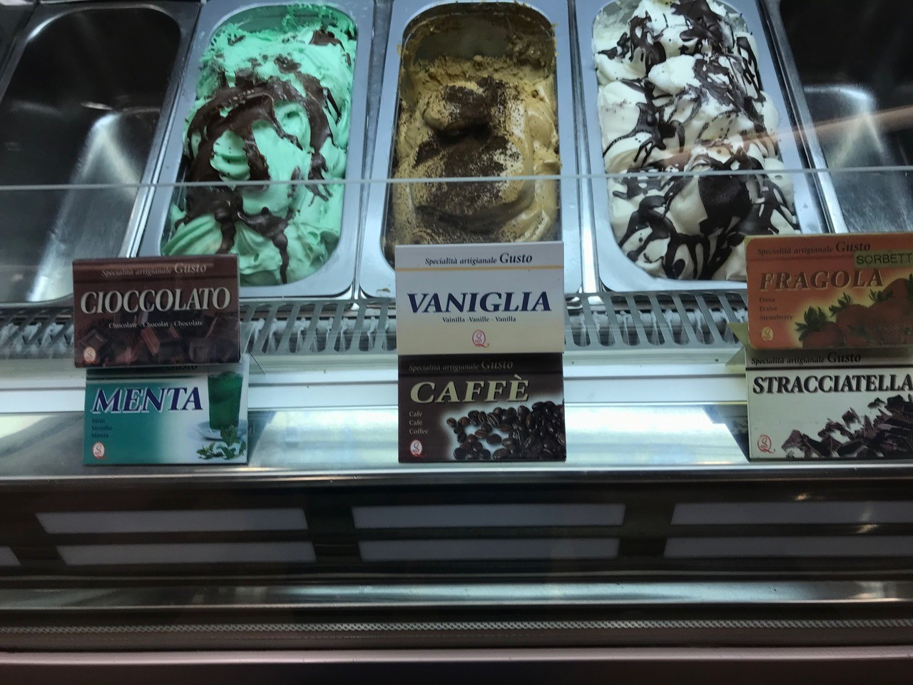gelato case with various flavors