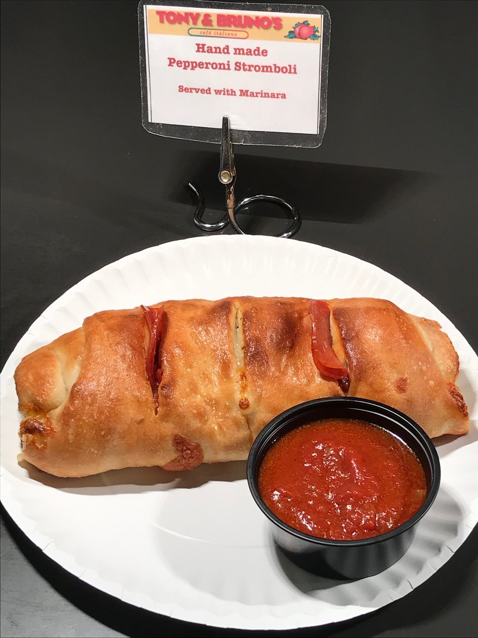 pepperoni stromboli with a side of sauce