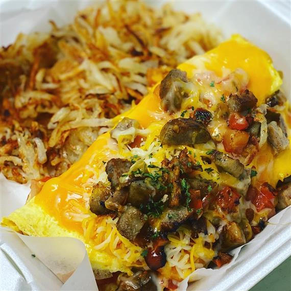 sausage, egg and cheese omelet with hashbrowns