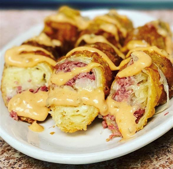 stateside deli's state rolls topped with 1000 island dressing