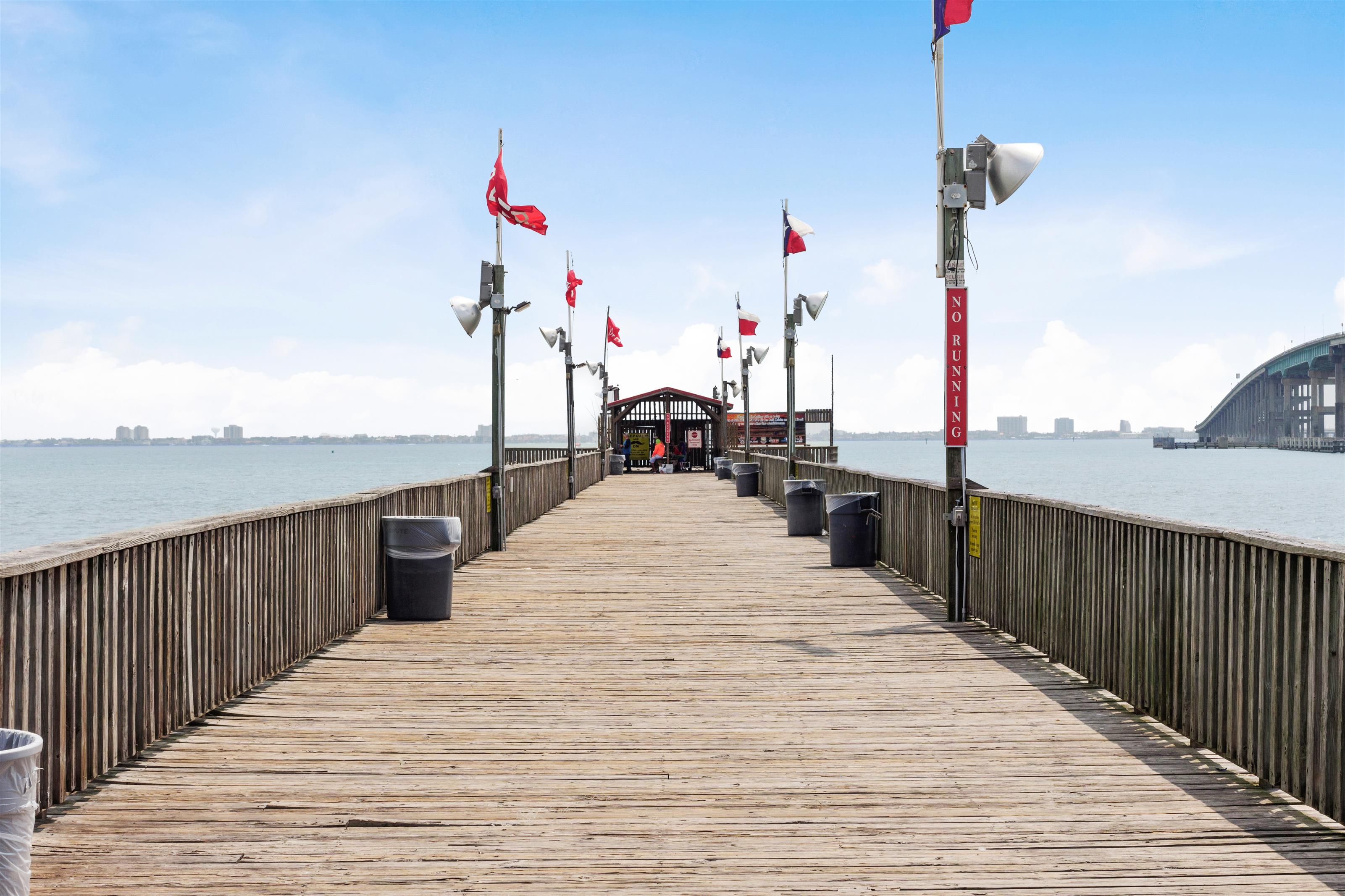 view of the Fishing Pier with flags, view of Causeway in the background