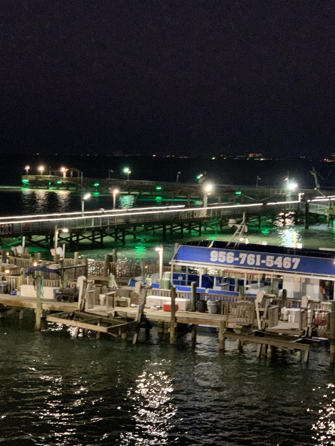 nighttime view of fishing boats docked at the pier