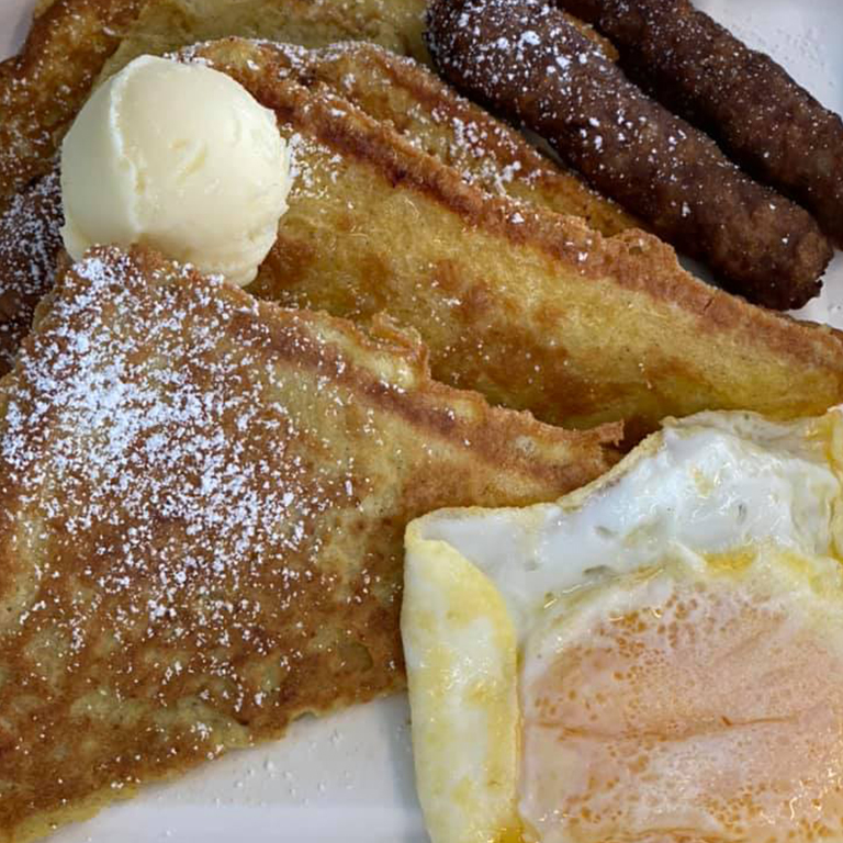 French toast with 2 sausage links and an egg