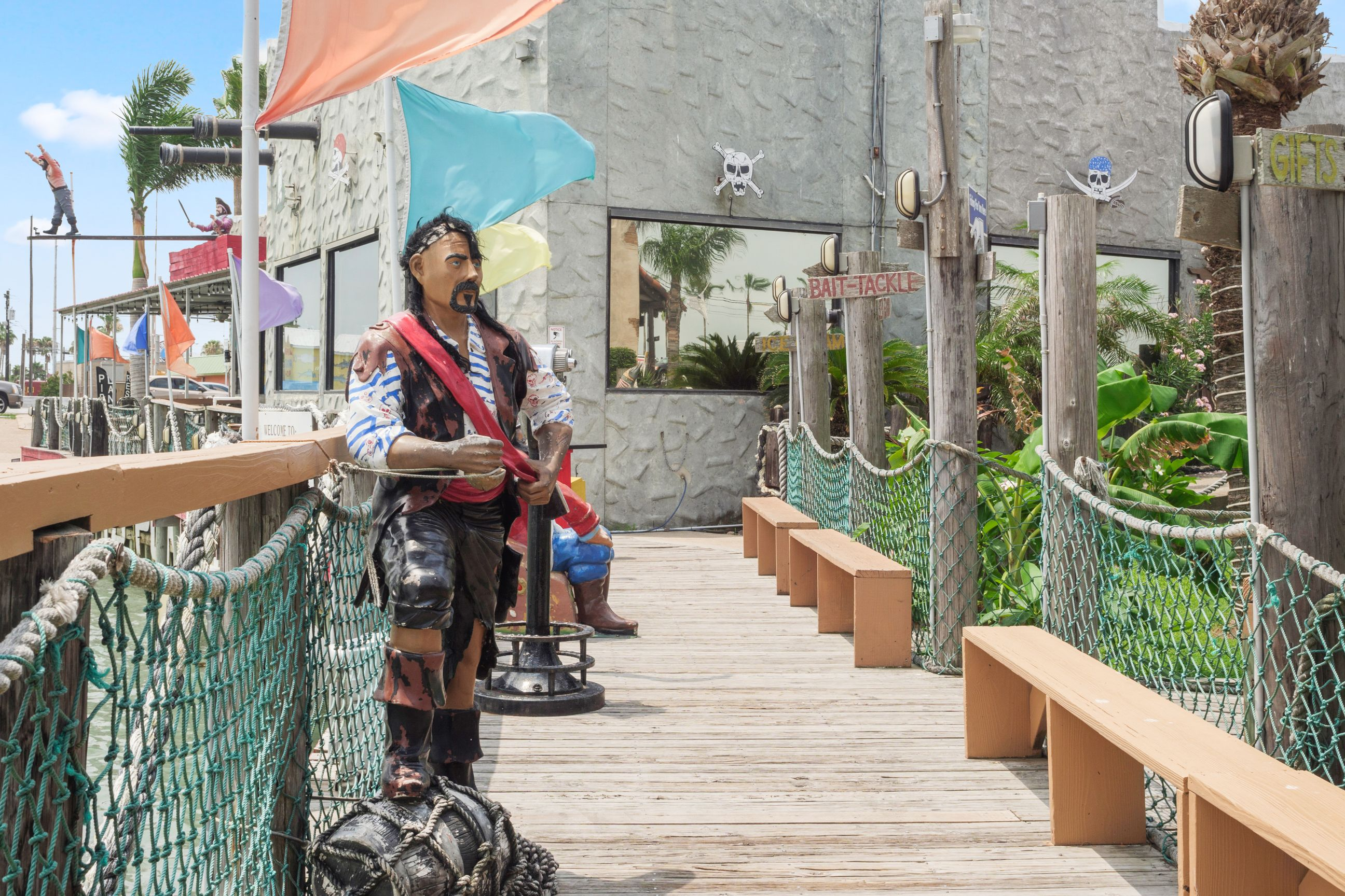 boardwalk leading into the restaurant with a Pirate statue