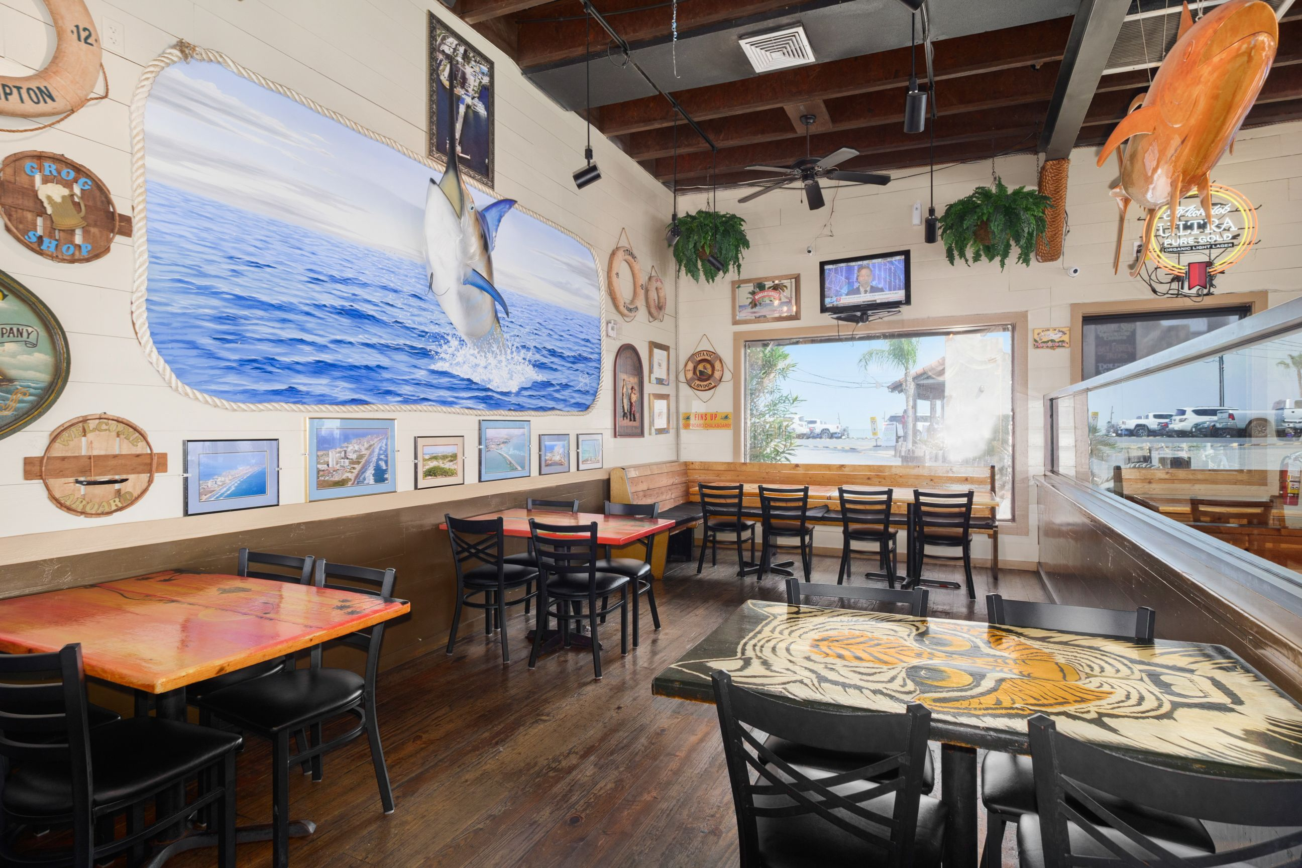 interior seating at restaurant with nautical decor