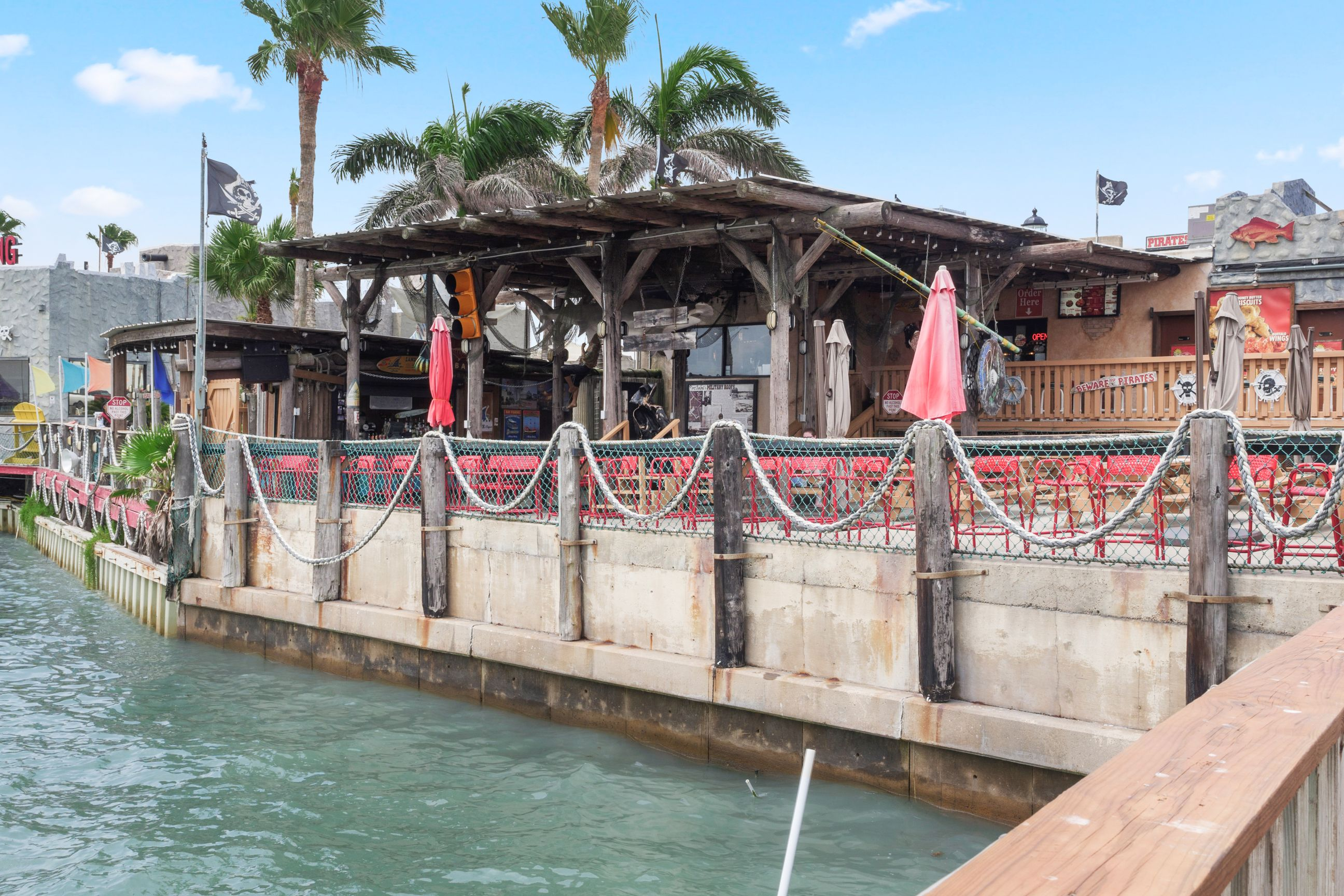 outdoor patio at pirates landing restautant with view of water