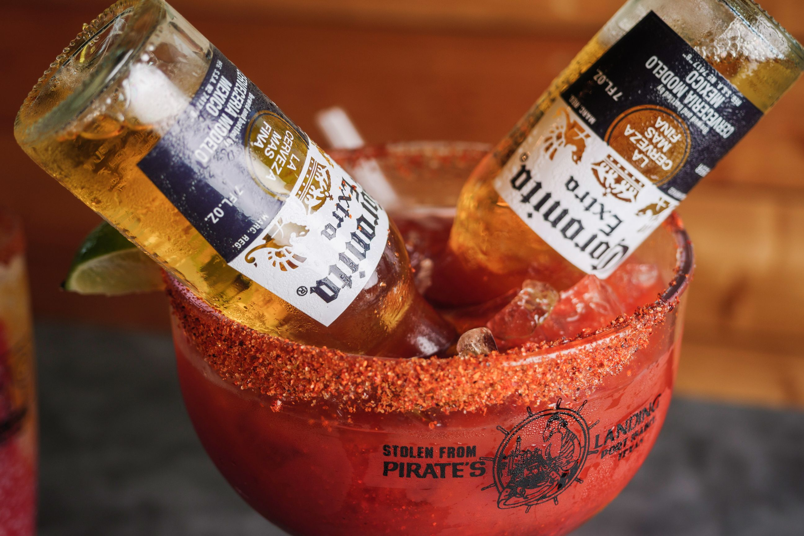 Michelada with two bottles of Corona beer and chili powder rim