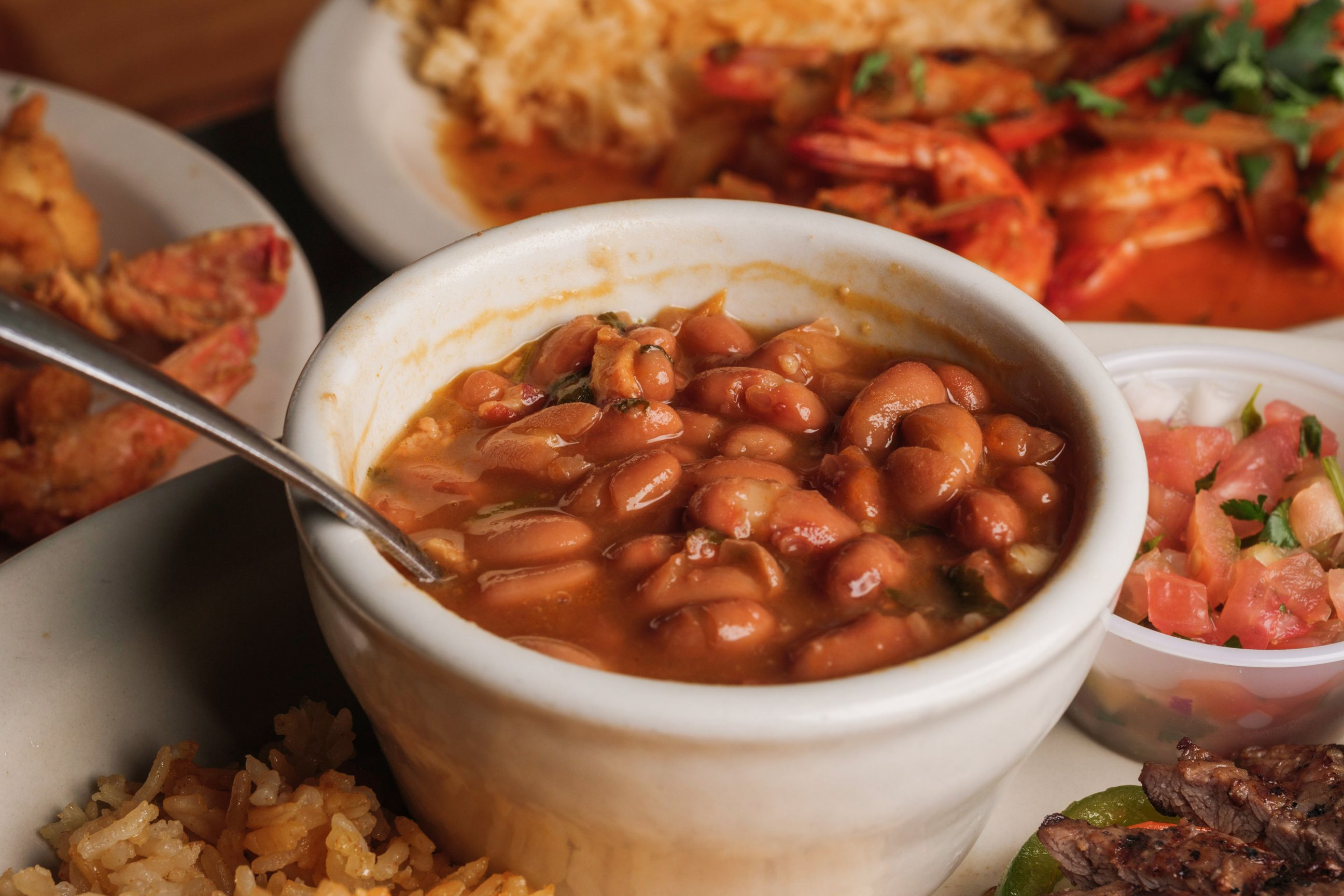 cup of baked beans with other entrees
