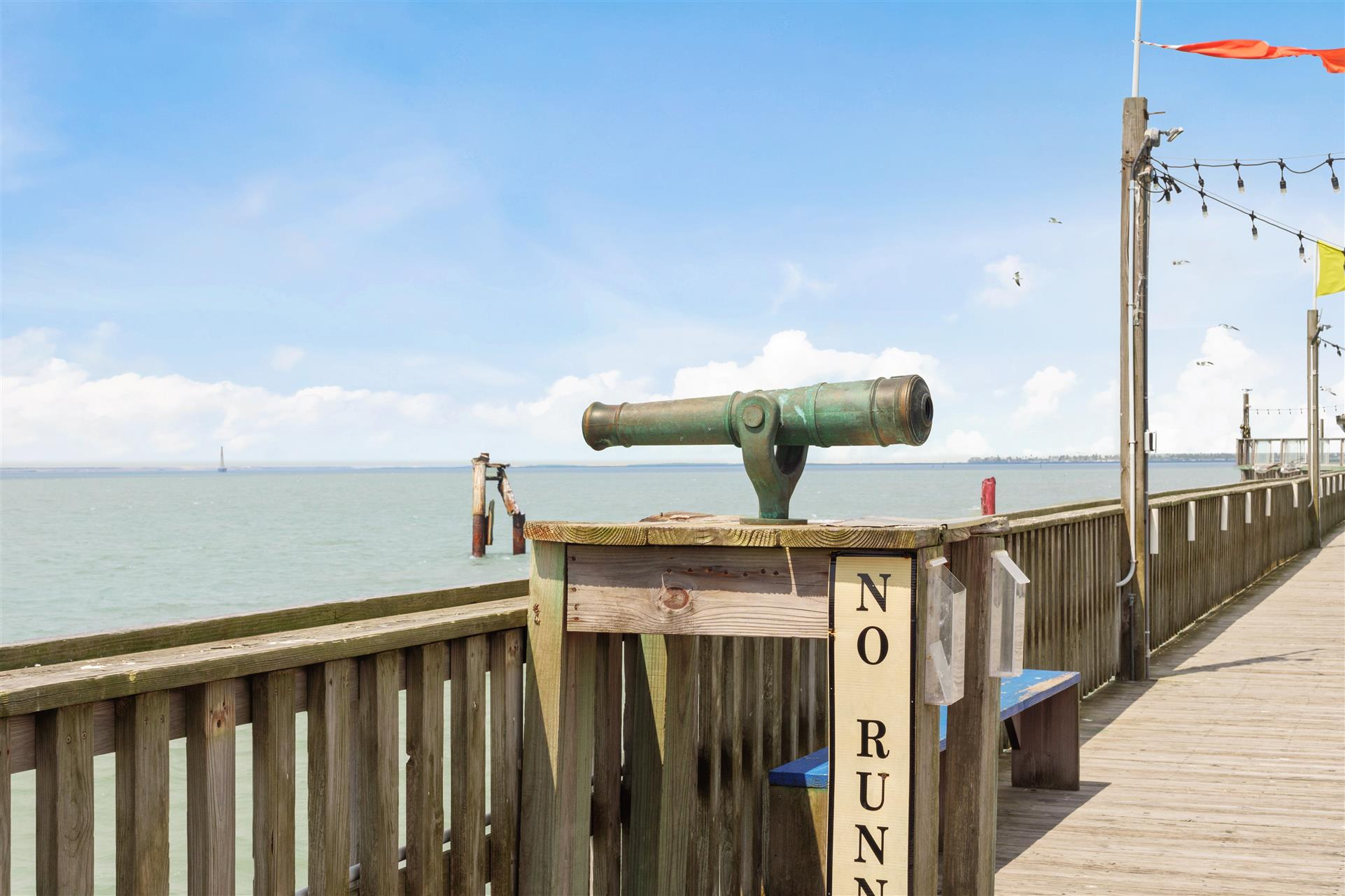 antique telescope on the pier