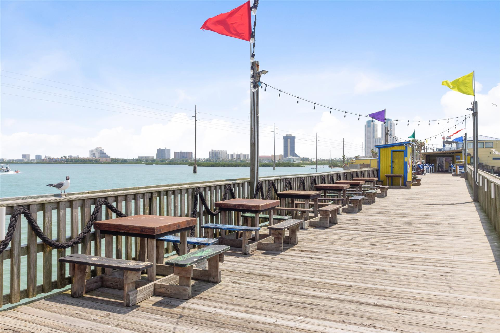 outdoor dining tables along the pier
