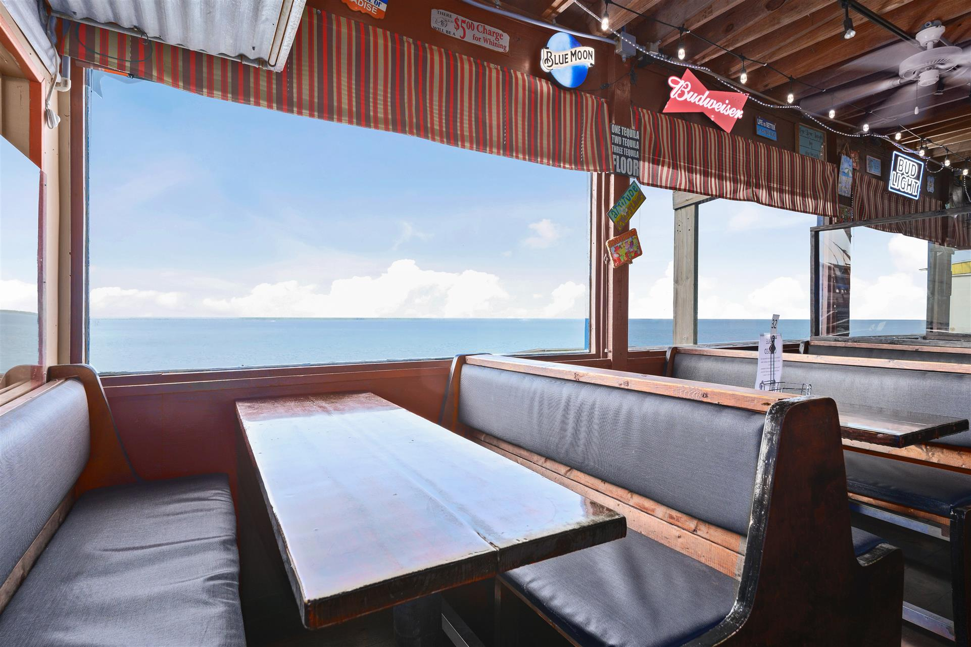 indoor dining booth overlooking a view of the water
