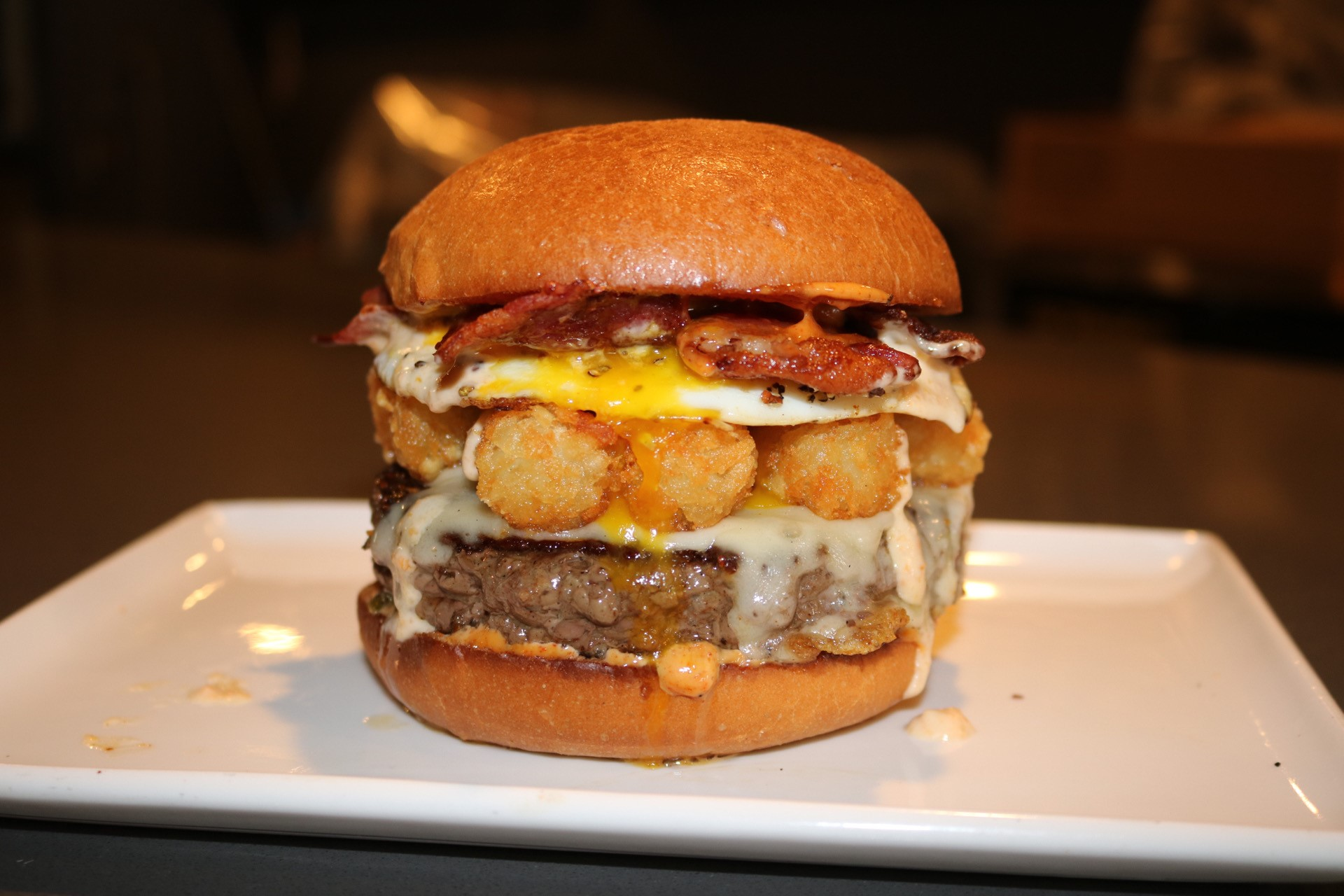 The Sunday Morning- cheeseburger with bacon, tater tots. and a fried egg