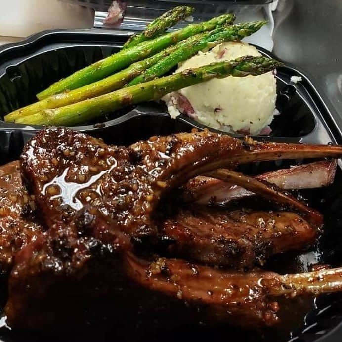 lamb with side of asparagus and mashed potatoes