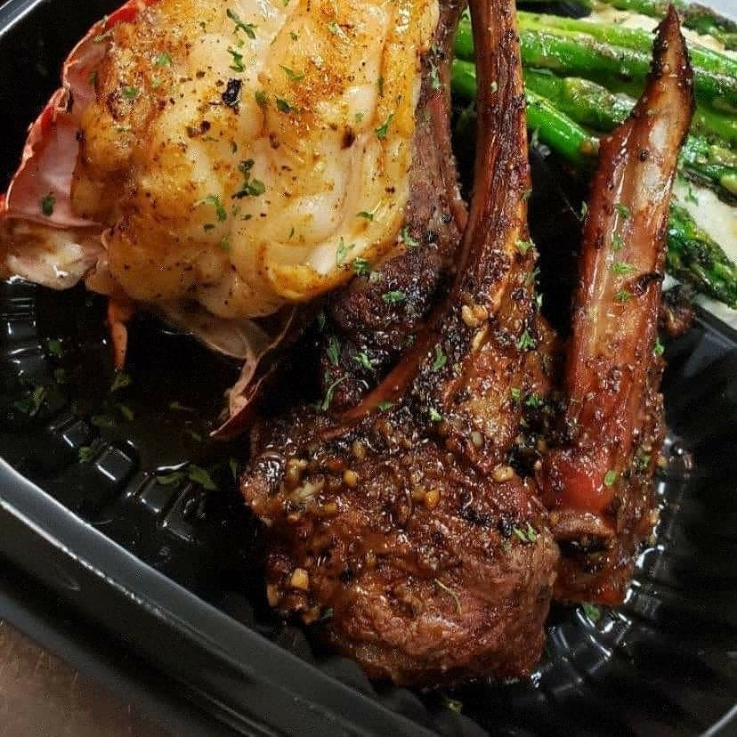 surf n turf dish with lobster tail and lamb chops