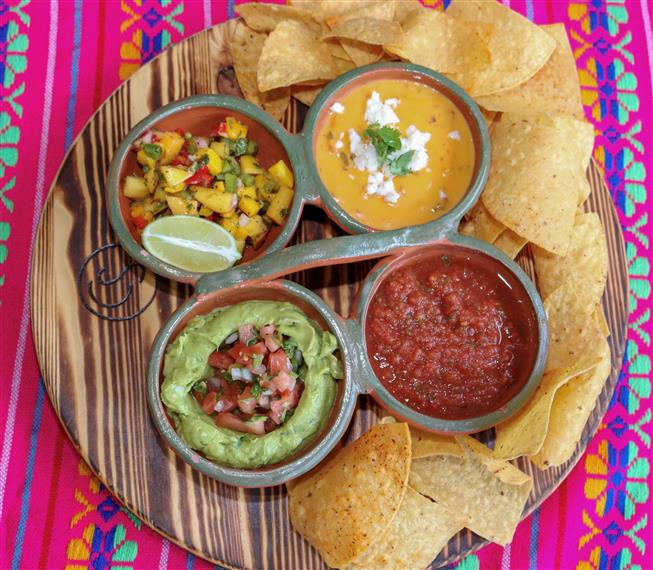 various salsas and dips with chips